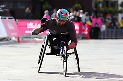 Johnboy Smith finishes third in the men's wheelchair race during the Vitality Big Half in London.