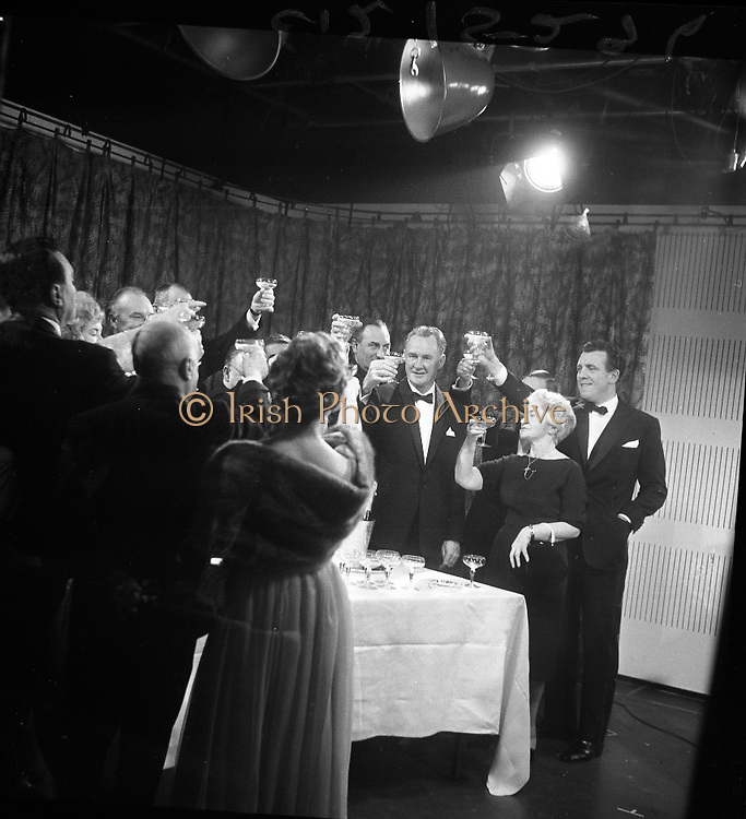 Inauguration of Teilifís Eireann, Montrose..1961..31.12.1961..12.31.1961..31st December 1961..Today saw the inaugeration and official opening of Telifís Éireann. Many dignitaries from the political,religious and entertainment life attended at the ceremony. ..Image shows some of the invited guests having a pre launch drink at the inaugeration ceremony.