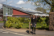 Saskya Huggins standing in front of Botley primary school, Low carbon hub have helped them get solar PV panels on the roof. Low Carbon Hub, Oxford. A community energy hub developing community owned renewable energy projects across Oxfordshire.  ALL publication MUST include the credit © Andrew Aitchison / ASHDEN.