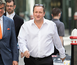 © Licensed to London News Pictures. 04/07/2017. London, UK. Newcastle United FC owner Mike Ashley arrives at the High Court for the second day of his case. Mr Ashley is in dispute with financial expert Jeff Blue over payments promised in relation to the share price of Sports Direct. Photo credit: Peter Macdiarmid/LNP