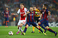Niki Zimling of AFC Ajax duels for the ball with Andres Iniesta of FC Barcelona during the UEFA Champions League, Group F, football match between FC Barcelona and Ajax Amsterdam on October 21, 2014 at Camp Nou Stadium in Barcelona, Spain. Photo MANUEL BLONDEAU / AOP PRESS / DPPI