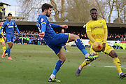 George Francomb of AFC Wimbledon cross hits Chey Dunkley of Oxford United FC during the Sky Bet League 2 match between AFC Wimbledon and Oxford United at the Cherry Red Records Stadium, Kingston, England on 27 February 2016. Photo by Stuart Butcher.