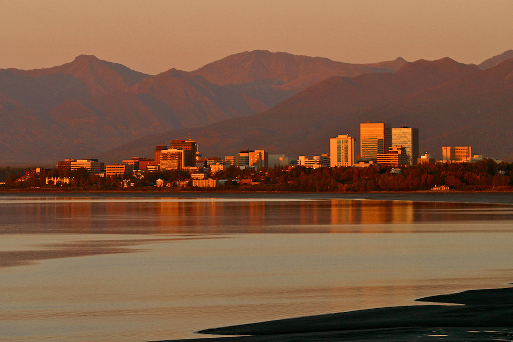 Anchorage skyline illuminated with setting sun from Point Woronzof