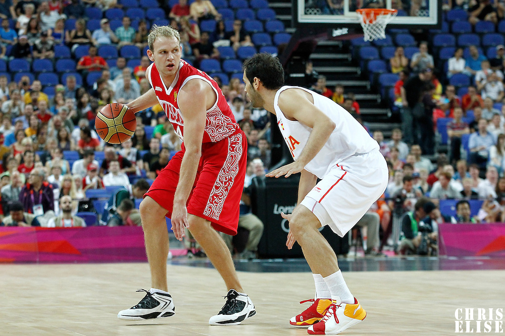 10 August 2012: Russia Anton Ponkrashov brings the ball upcourt during 67-59 Team Spain victory over Team Russia, during the men's basketball semi-finals, at the North Greenwich Arena, in London, Great Britain.