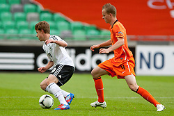 Maximilian Meyer of Germany and Jorrit Hendrix of Netherlands during the UEFA European Under-17 Championship Final match between Germany and Netherlands on May 16, 2012 in SRC Stozice, Ljubljana, Slovenia. (Photo by Urban Urbanc / Sportida.com)