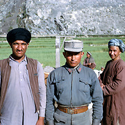 Late Summer? 1965<br /> Two men and a policeman (jalb). Pushtun and Uzbek. Good for variations in clothing and headgear.