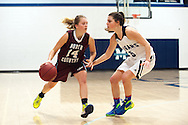 North Country's Hailey Morse (14) dribbles the ball past MMU's Perry Willett (5) during the girls basketball game between the North Country Falcons and the Mount Mansfield Cougars at MMU high school on Monday night February 15, 2016 in Jericho. (BRIAN JENKINS/for the FREE PRESS)