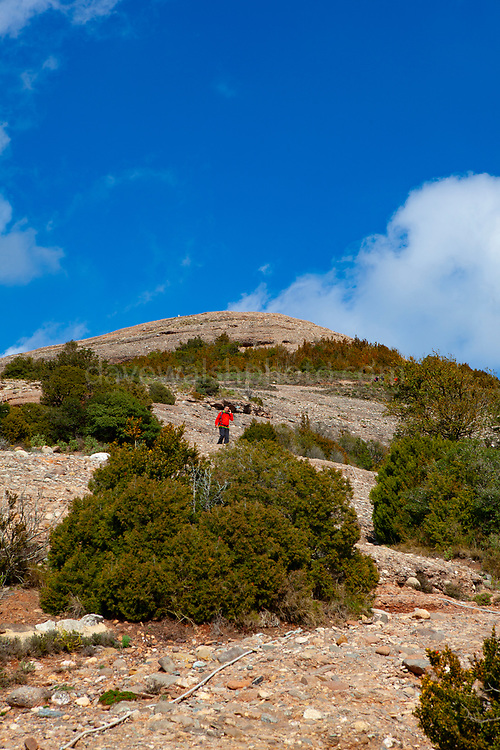 A hiker on the 1056 metre high mountain of Montcau, in the Parc Natural Sant Llorenc del Munt massif, near Barcelona, Catalonia.