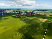 Nederland, Noord-Holland, Gemeente Weesp, 16-04-2012; Aetsveldsche Polder met Weesp in de achtergrond, IJsselmeer aan de horizon, links IJburg. .De polder is in gebruik als grasland. Onregelmatige percelering (gevolg van de ontginning). Aardkundig monument, klei op veen..Irregular square fields caused by cultivation in the polder. IJsselmeer (water) in the background. Geological monument, clay on peat..luchtfoto (toeslag), aerial photo (additional fee required);.copyright foto/photo Siebe Swart