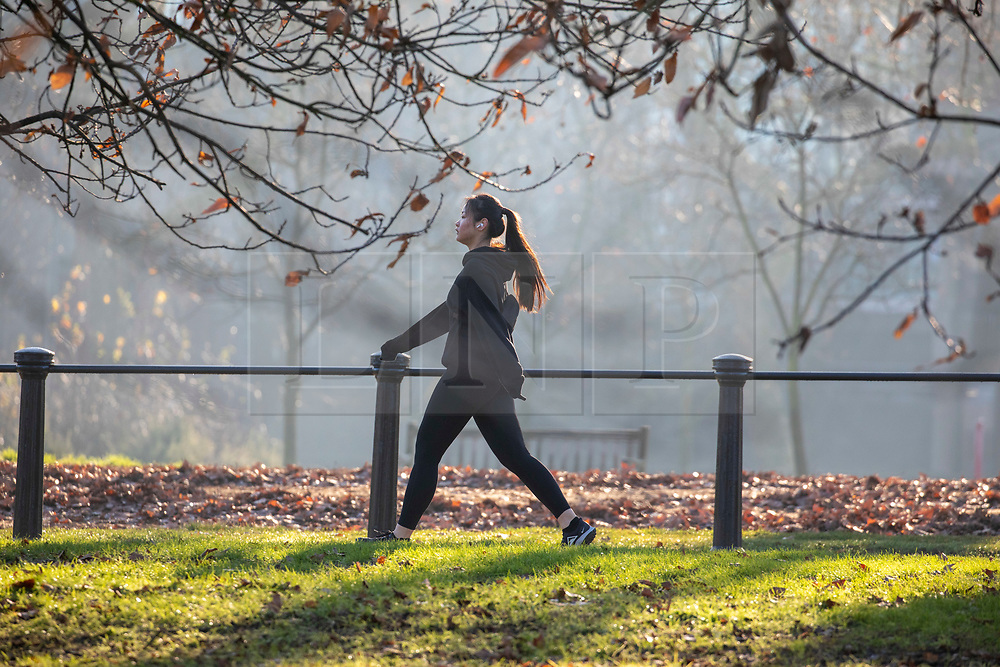 © Licensed to London News Pictures. 30/12/2019. London, UK. A walker enjoys an unseasonably mild sunny day in Hyde Park, London as forecasters predict warm weather and possibly the the warmest New Year's Eve for over a 170 years. Photo credit: Alex Lentati/LNP
