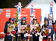 Poland, Wisla Malinka - 2017 November 18: Polish team (L-R) Kamil Stoch and Maciej Kot and Dawid Kubacki and  Piotr Zyla with runne-up trophy pose while awarding ceremony during FIS Ski Jumping World Cup Wisla 2017/2018 - Day 2 at jumping hill of Adam Malysz on November 18, 2017 in Wisla Malinka, Poland.<br /> <br /> Mandatory credit:<br /> Photo by &copy; Adam Nurkiewicz<br /> <br /> Adam Nurkiewicz declares that he has no rights to the image of people at the photographs of his authorship.<br /> <br /> Picture also available in RAW (NEF) or TIFF format on special request.<br /> <br /> Any editorial, commercial or promotional use requires written permission from the author of image.