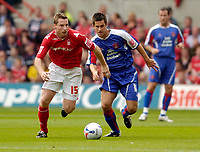 Photo: Leigh Quinnell.<br /> Nottingham Forest v Carlisle United. Coca Cola League 1. 16/09/2006. Forests Neil Harris gets away from Carlisles Paul Thirwell.