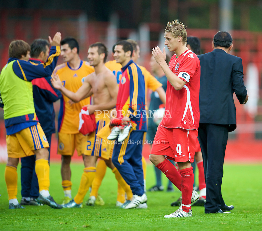 WREXHAM, WALES - Wednesday, August 20, 2008: Wales' captain David Edwards walks off dejected as Romania players celebrate during the UEFA Under 21 European Championship Qualifying Group 10 match at the Racecourse Ground. (Photo by David Rawcliffe/Propaganda)