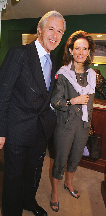 MR & MRS MARTIN SUMMERS he is the leading art dealer, at an antiques fair in London on 9th June 1999.MSY 66