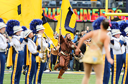 Oct 28, 2017; Morgantown, WV, USA; The West Virginia Mountaineers mascot leads the West Virginia Mountaineers onto the field before their game against the Oklahoma State Cowboys at Milan Puskar Stadium. Mandatory Credit: Ben Queen-USA TODAY Sports