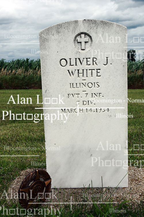 17 July 2009:  Hittle Grove cemetery, historical burial site of the Orndorff - Albright massacre of 1860, is located in Tazwell County Illinois. Grave and ofOliver J. White..  ..About the massacre:..On the morning of the 12th of Oct. A.D. 1860, the husband and father in whose memory this monument is erected, was called away on business, from his residence three miles southeast of Delavan, Illinois. He left his family, consisting of his wife and two small daughters.  When he returned, no little ones ran to greet him, as was their custom. This caused alarm for the welfare of his dear ones.  Entering the house, he found his wife and daughters, whom he had left in perfect health and joyful spirits a few hours earlier.  They had been  murdered while he was absent. They were now lying prostrate and weltering in their blood.  The mother and younger daughter were already dead.  The older daughter was still living and moaning piteously but unable to whisper one word to her father.  At four o'clock the next morning, death ended her suffering.  Kind friends carried them in one coffin, to their last resting place...The murderer was a former hired hand. As he was robbing the family. He killed them in order to cover up the crime.  He was later found hiding in a corn crib in Logan County and was returned to Pekin where he became the first man to be hung in Tazewell County.  .