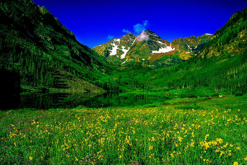 The Maroon Bells (Maroon Peak and North Maroon Peak on right) with Maroon Lake in the foreground, near Aspen, Colorado USA