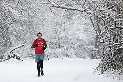 © Licensed to London News Pictures. 01/02/2019. London, UK. A runner on Hampstead Heath, north London, after snow fell overnight. Photo credit: Rob Pinney/LNP