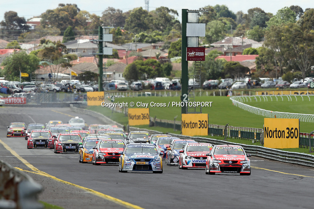 Jamie Whincup (TeamVodafone Holden) and Mark Winterbootom lead the start of the 2011 Norton 360 Sandown Challenge ~ Race 26 of the 2011 V8 Supercar Championship Series. Sandown International Raceway, Melbourne on Sunday 20 November 2011. Photo © Clay Cross / photosport.co.nz