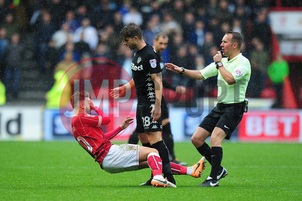 Matty Taylor of Bristol City goes down after Gaetano Berardi of Leeds United confronts him - Mandatory by-line: Dougie Allward/JMP - 21/10/2017 - FOOTBALL - Ashton Gate Stadium - Bristol, England - Bristol City v Leeds United - Sky Bet Championship