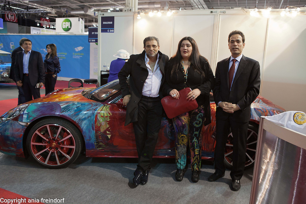 """Saudi artist Shalimar Sharbatly, """"Shalemar"""" and her family, during the Salon Mondial Automobile. Her art painting on a Porsche car, Paris, France. (left) Khaled Youssef, is an Egyptian director and film writer"""