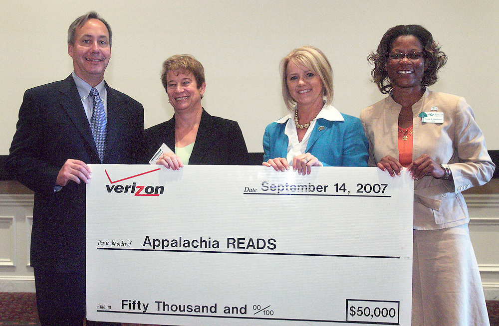 18388.Greg Shepherd, dean of the Scripps College of Communication; Gale Given, President for Verizonís Great Lakes Region; Carolyn Ervin, program director for Appalachia Reads; and Dr. Renee Middleton, Dean of the College of Education hold a ceremonial check for $50,000 from Verizon  for Appalachia Reads  on Friday, September 14, 2007 in Athens, Ohio. (Photo by Kevin Riddell)
