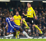 Kurt Zouma of Chelsea tries to prevent Daniel Tozser of Watford from progressing during the FA Cup match at Stamford Bridge, London<br /> Picture by David Horn/Focus Images Ltd +44 7545 970036<br /> 04/01/2015