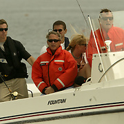 President Bush, center left,daughter Jenna Bush, center right, and former President George H.W. Bush cruise on 'Fidelity II' during a fishing expedition near the family home Sunday, July 7, 2002, in Kennebunkport, Maine.  President Bush is spending the Independence Day weekend in Kennebunkport, Maine, home of his parents...Photo by Khue Bui