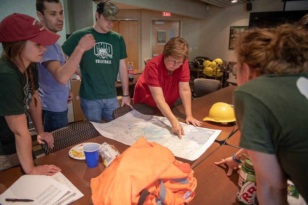 OHIO Associate Professor Dr. Viorel Popescu (blue shirt) helps train and coordinate Conservation Ecology Lab students working on  research at the Wayne National Forest headquarters. Photo by Ben Siegel