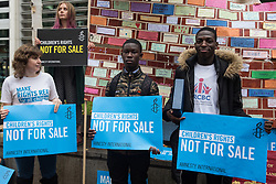 London, UK. 25 November, 2019. Daniel (c) and Samson Adeola (r), former clients of the Project for the Registration of Children as British Citizens (PRCBC), join campaigners from Amnesty International UK's Children's Human Rights Network and PRCBC outside the Home Office to hand in a letter calling on the British Government to stop selling children's rights. Currently, the Home Office charges £1,012 for citizenship applications, including for children living in poverty or local authority care, whilst the cost of processing an application is £372. Thousands of children with rights to British citizenship are prevented from claiming their rights due to excessive fees.