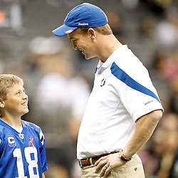 October 23, 2011; New Orleans, LA, USA; Indianapolis Colts quarterback Peyton Manning (18) talks to a young fan prior to kickoff of a game against the New Orleans Saints at the Mercedes-Benz Superdome. Mandatory Credit: Derick E. Hingle-US PRESSWIRE / © Derick E. Hingle 2011