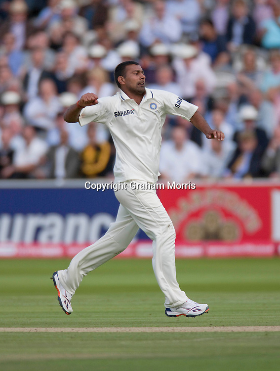 Praveen Kumar celebrates taking the wicket of Matt Prior during the first npower Test Match between England and India at Lord's Cricket Ground, London.  Photo: Graham Morris (Tel: +44(0)20 8969 4192 Email: sales@cricketpix.com) 22/07/11