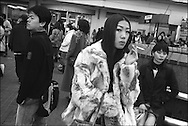 People standing in Hachiko Square, a popular rendezvous point outside Shibuya station, Tokyo, Japan.