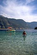 People swimming in the sea, Oludeniz beach, Fethiye, Turkey