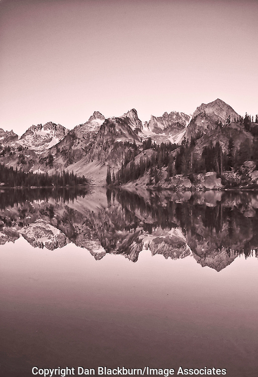 Sunrise on the Mountains Surrounding Alice Lake in the Sawtooth Mountains Wilderness of Idaho with Reflection in the lake.