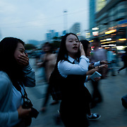 Young fans run to catch a glimpse of movie stars at Haeundae BIFF Village.