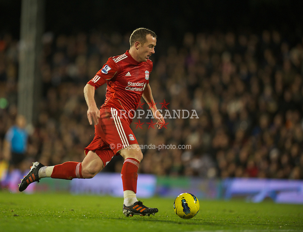 LONDON, ENGLAND - Monday, December 5, 2011: Liverpool's Charlie Adam in action against Fulham during the Premiership match at Craven Cottage. (Pic by David Rawcliffe/Propaganda)