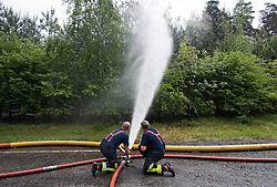 © licensed to London News Pictures. 07/05/2011. Crowthorne, UK. Firefighters water forest are as apreventative measure as they continue to tackle fires in woodland in Swinley Forest, Crowthorne, Berkshire today (07/05/2011).  Recent rainfall has helped to dubdue the fires which have been sweeping through an area of about 300 hectares, since Monday. See special instructions for usage rates. Photo credit should read LNP