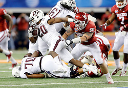 Texas A&M Aggies running back Trey Williams (20) runs with the ball and gets tackled by Oklahoma Sooners linebacker Tom Wort (21) during the 77th AT&T Cotton Bowl Classic between the Texas A&M University Aggies and the Oklahoma University Sooners at Cowboys Stadium in Arlington, Texas. Texas A&M wins the 77th AT&T Cotton Bowl Classic against Oklahoma, 41-13.