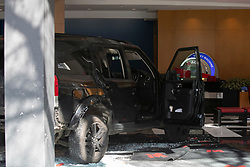 © Licensed to London News Pictures. 16/03/2020. London, UK. A Land Rover Discovery remains in a branch of Metro Bank on the Kings Road in Chelsea after the vehicle was reportedly driven into the bank . Photo credit: George Cracknell Wright/LNP