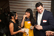 New York, NY - March 30, 2015: Party hostess Leiti Hsu samples on of the snacks served at the fundraiser for Heritage Radio Network at All'onda, near Union Square.<br /> <br /> CREDIT: Clay Williams for Heritage Radio Network.<br /> <br /> &copy; Clay Williams / claywilliamsphoto.com