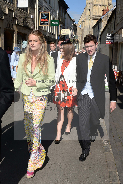 Left to right, CRESSIDA BONAS, PRINCESS EUGENIE and JACK BROOKSBANK at the wedding of Lady Natasha Rufus Isaacs to Rupert Finch held at St.John The Baptist Church, Cirencester, Gloucestershire, UK on 8th June 2013.