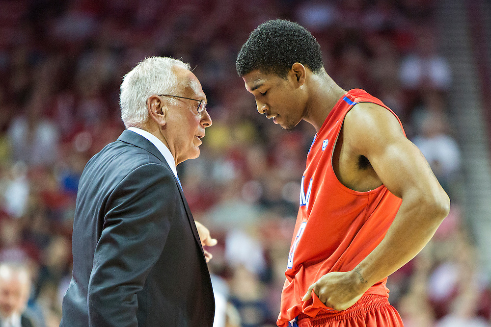 FAYETTEVILLE, AR - NOVEMBER 18:  Head Coach Larry Brown talks with Crandall Head #13 of the SMU Mustangs during a game against the Arkansas Razorbacks at Bud Walton Arena on November 18, 2013 in Fayetteville, Arkansas.  The Razorbacks defeated the Mustangs 89-78.  (Photo by Wesley Hitt/Getty Images) *** Local Caption *** Larry Brown; Crandall Head