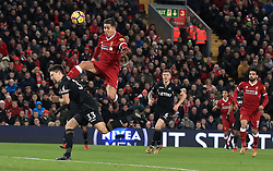 Liverpool's Roberto Firmino and Swansea City's Federico Fernandez (left) battle for the ball during the Premier League match at Anfield, Liverpool.