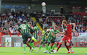 Adebayo Akinfenwa heading clear the danger during the Sky Bet League 2 match between Crawley Town and AFC Wimbledon at the Checkatrade.com Stadium, Crawley, England on 15 August 2015. Photo by Michael Hulf.