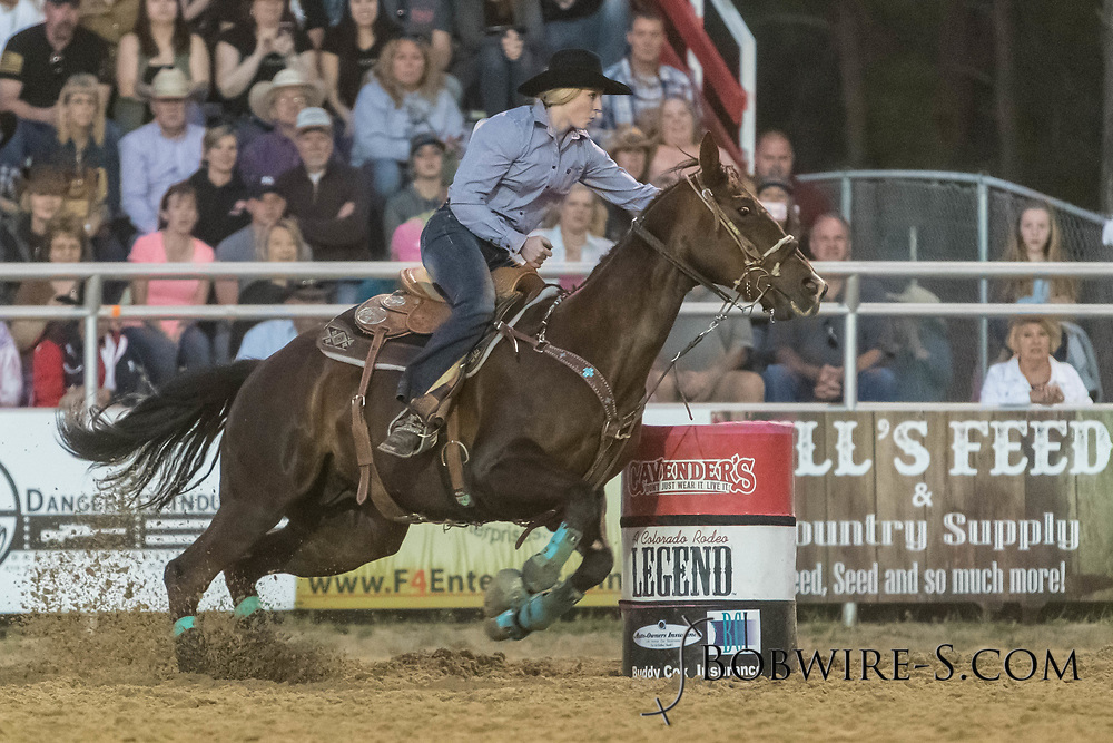 Megan Best makes her run in the barrel racing during the second performance of the Elizabeth Stampede on Saturday, June 2, 2018.