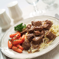 Beef Stroganoff with noodles and carrots.