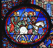 Julian and his fellow knights march into battle during the crusades. Julian rides a white horse, his feet in stirrups, and his banner indicates that he is now a feudal lord. Section of Julian on a crusade with comrades, 1215-25, from the Life of St Julian the Hospitaller window in the chapel of St Julian in the ambulatory of Chartres Cathedral, Eure-et-Loir, France. Chartres cathedral was built 1194-1250 and is a fine example of Gothic architecture. Most of its windows date from 1205-40 although a few earlier 12th century examples are also intact. It was declared a UNESCO World Heritage Site in 1979. Picture by Manuel Cohen