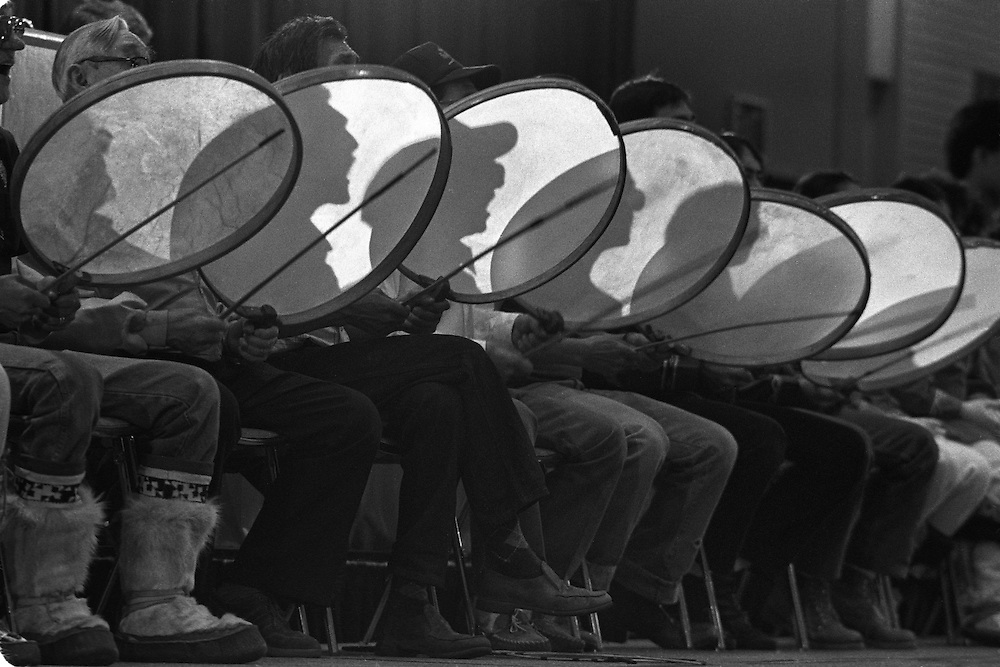 USA, Alaska, Anchorage, Yupik Eskimo drummers cast shadows on drums during Alaska Federation of Natives conference