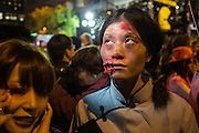 New York, NY, October 31, 2013. A woman in ghoulish makeup as if her face had been torn open in the annual Greenwich Village Halloween Parade.